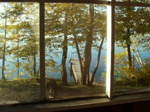 Looking out the porch of cabin number 4 at the dock and lake